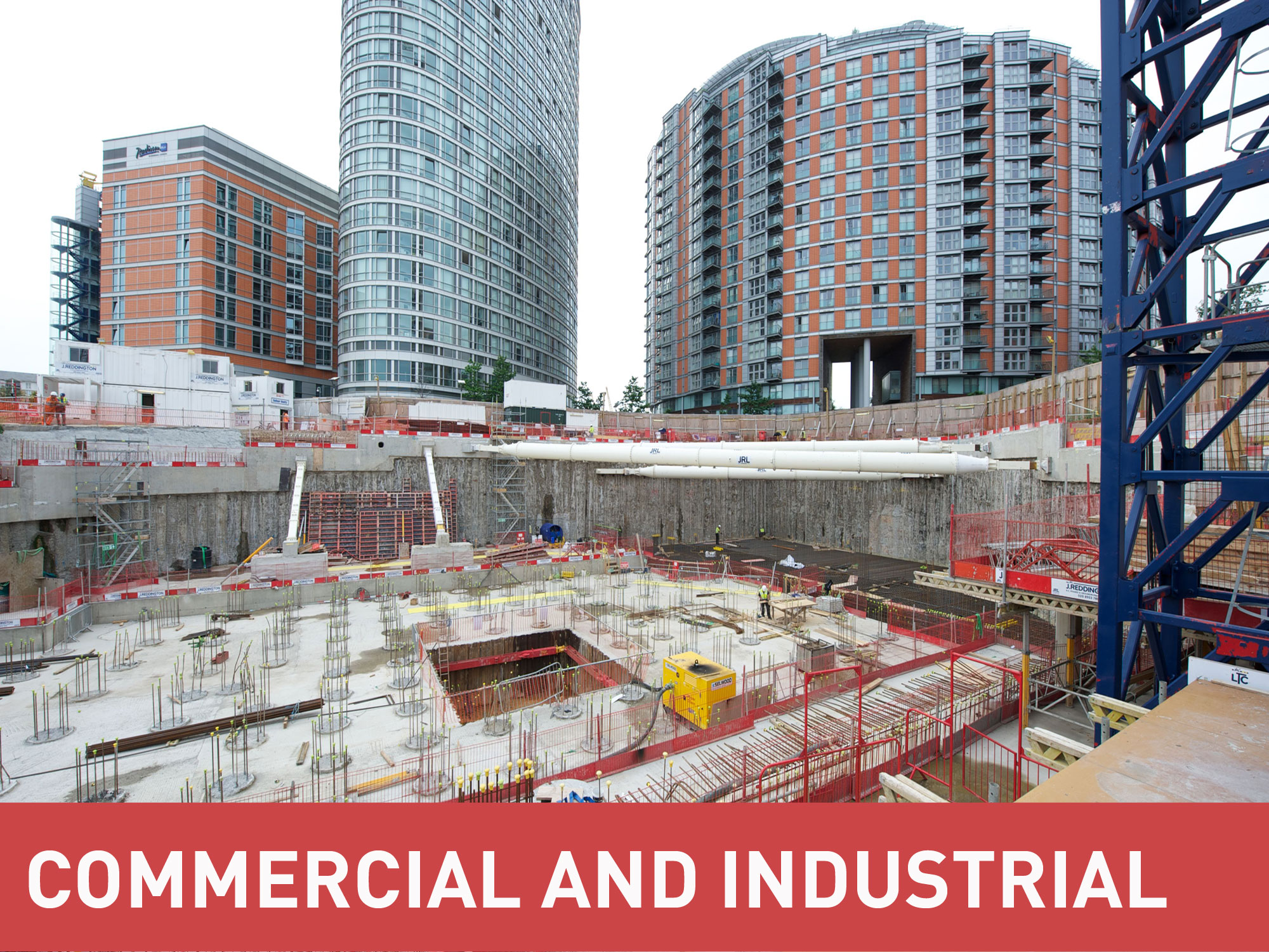 MGF Commercial and Industrial category banner in front of a photo of a major excavation between apartment blocks