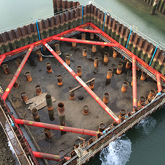 Aerial view of MGF 406 UC Brace installed at an excavation by the water