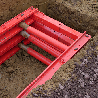Red MGF End Strut fitted into a trench on site