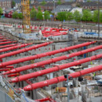 Drone photo of installed red MGF hydraulic braces on site