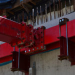 Close up of red hydraulic braces installed and connected to one another
