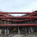 Large red MGF struts inside excavation onsite